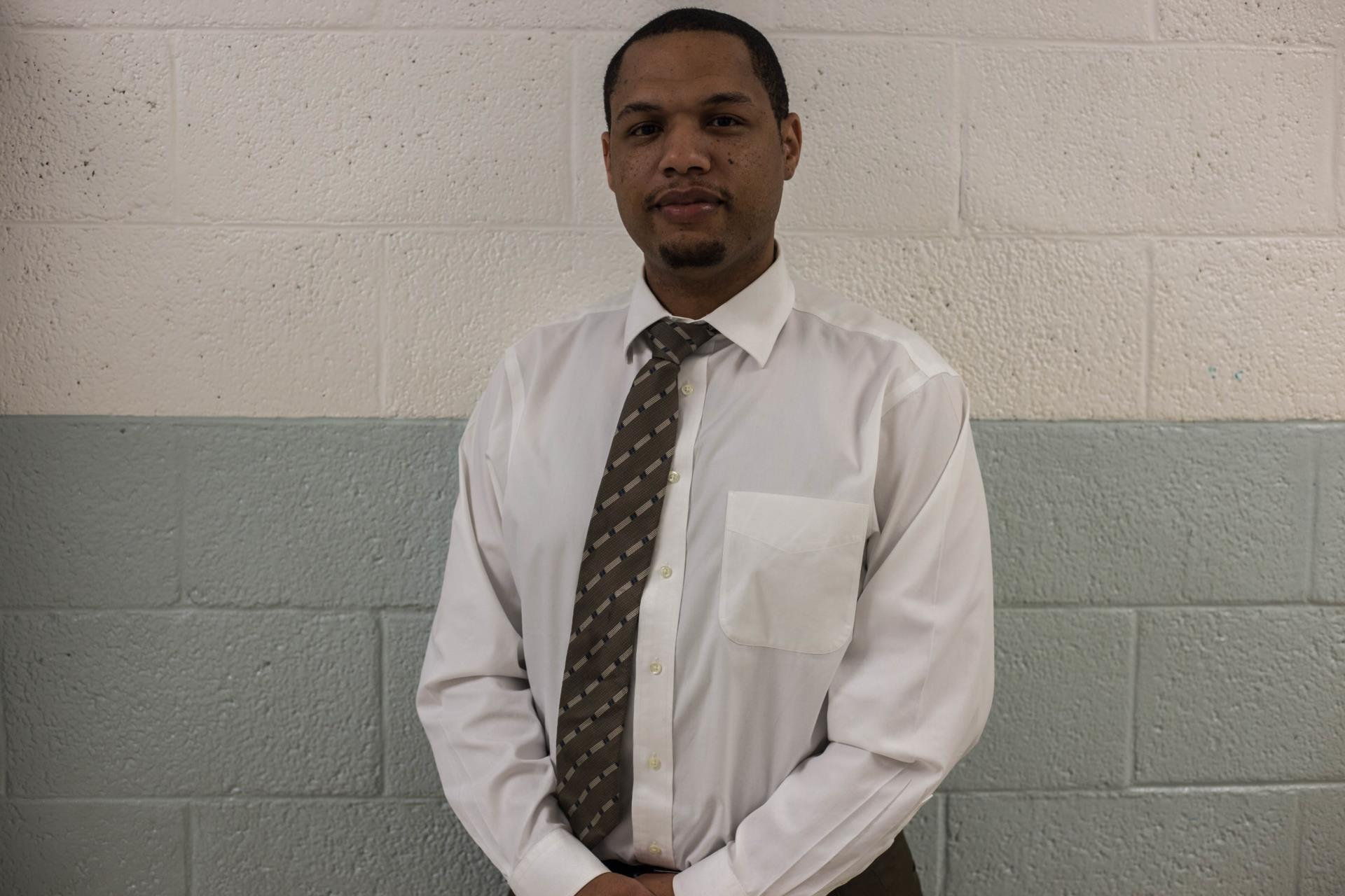 man in white shirt with necktie