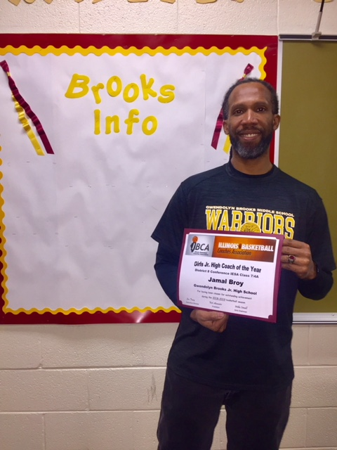 Jamal Broy District 8 Coach of the Year with his certificate.