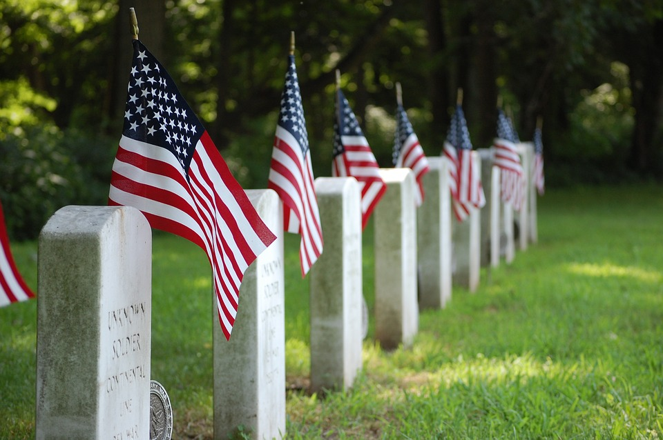 Memorial Day gravestones with American flags