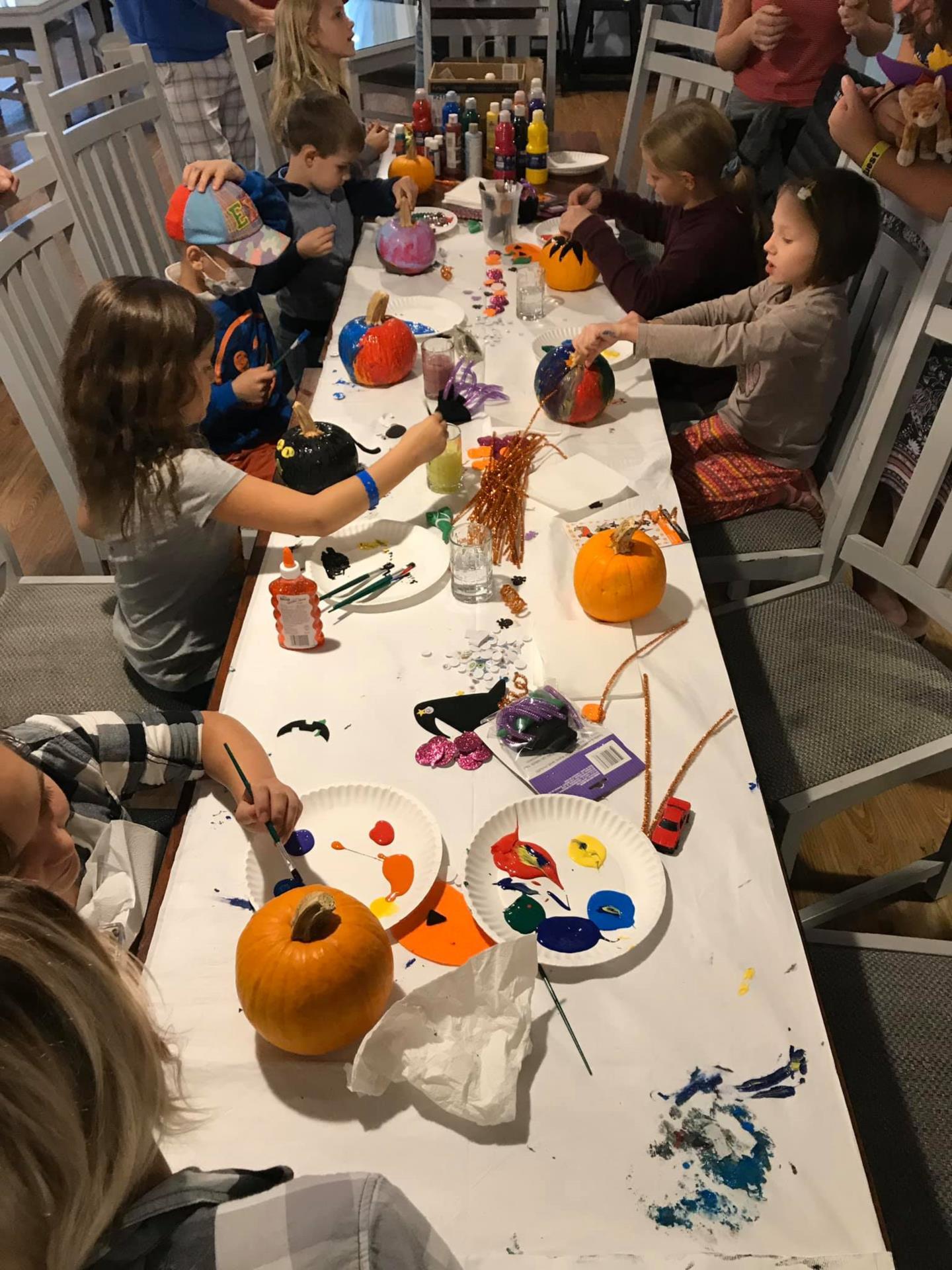 Children Painting Pumpkins