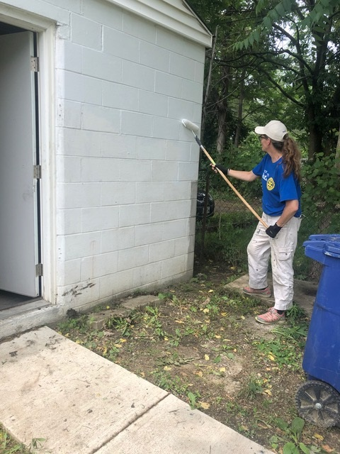 Jessica painting a garage