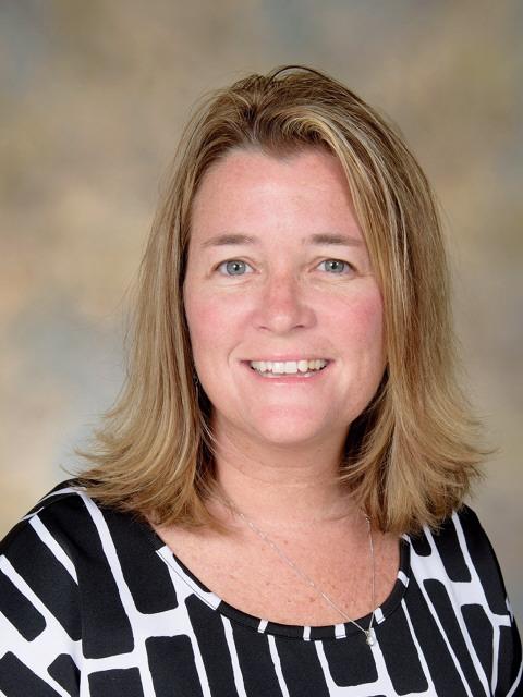 Amy Molnar, Coy Principal