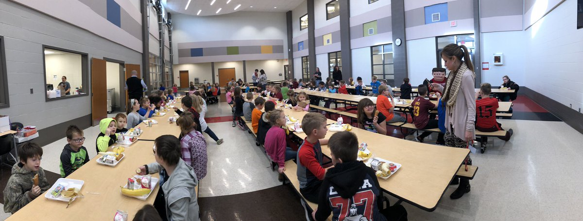 CES students eating at a Kindness Recognition Breakfast in Spring 2018.