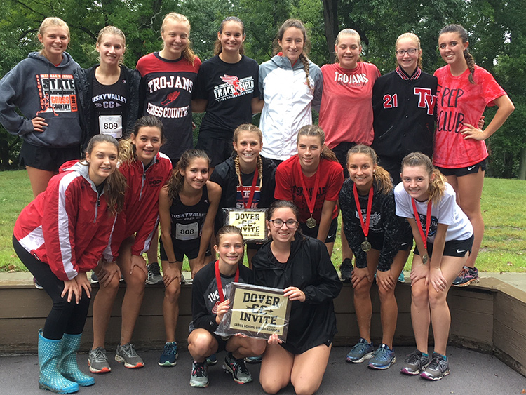 The girls' cross country team poses with the Dover Invitational trophy.