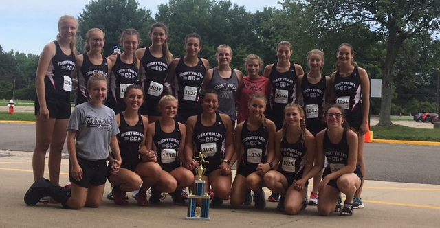 Girls Cross Country team poses with Dave Clegg championship trophy
