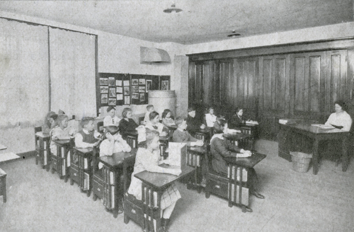 Students seated in a classroom at the barracks school in 1919