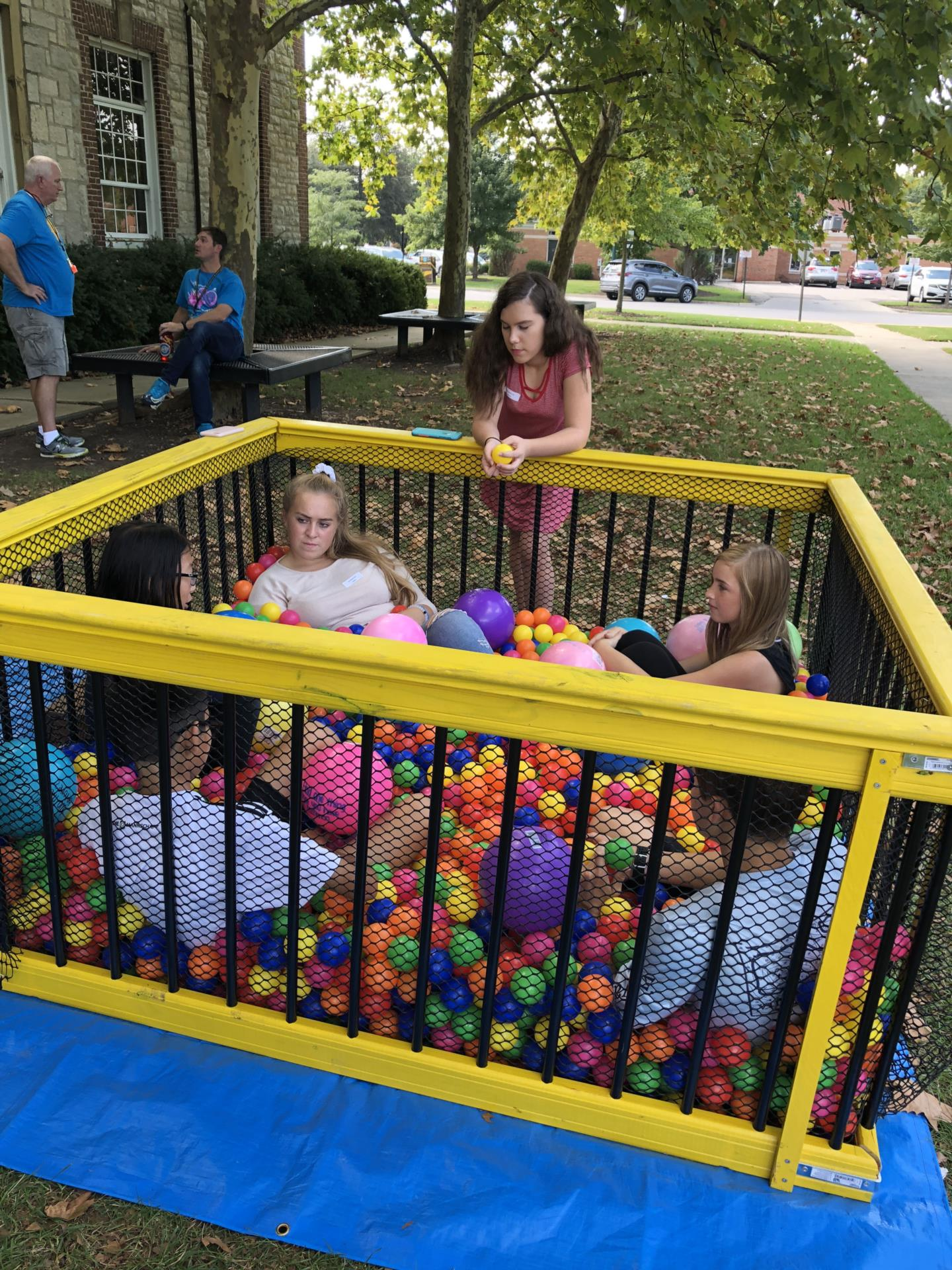 Students from Jones and the high school engaging in conversations in a ball pit